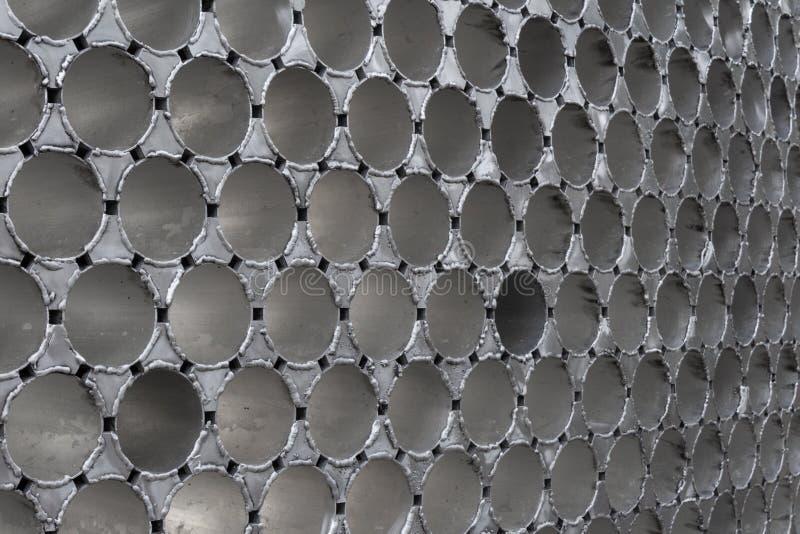 被焊接的铝管背景墙壁  免版税库存照片