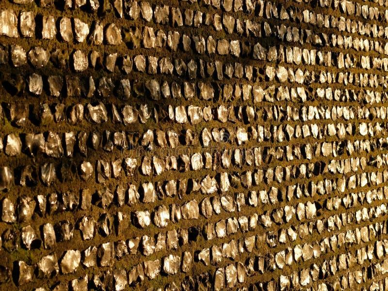 被猛敲的火石墙壁 库存照片