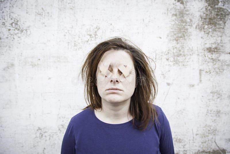 被盖的妇女眼睛 库存照片