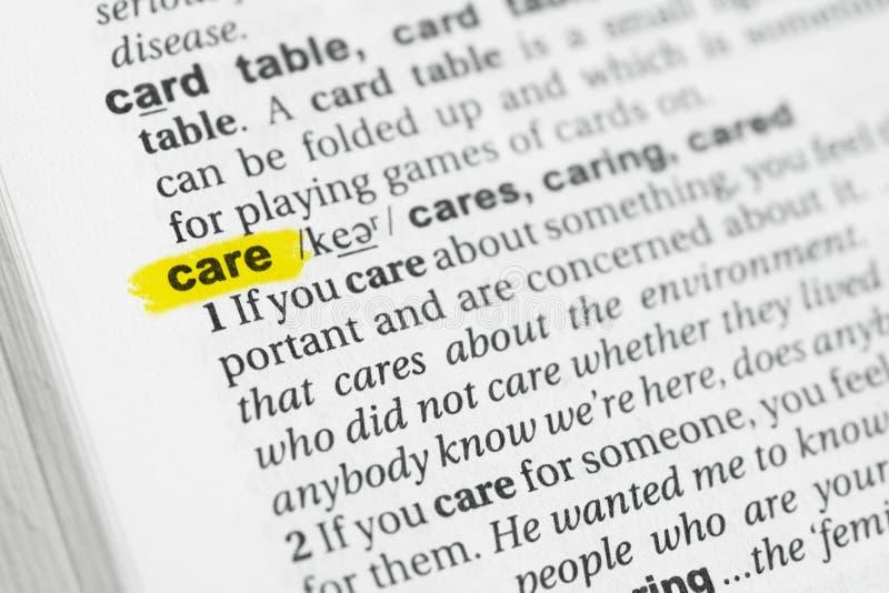 被突出的英国词`关心`和它的定义在字典 库存照片