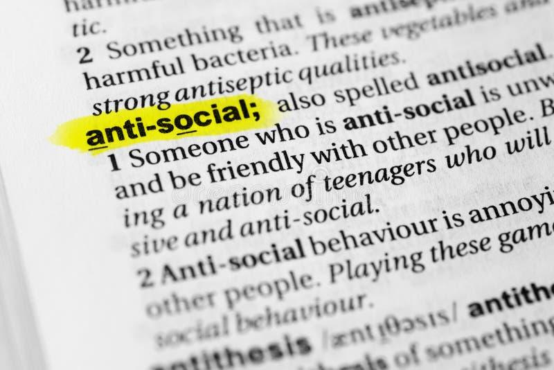 被突出的英国词`反社会`和它的定义在字典 图库摄影