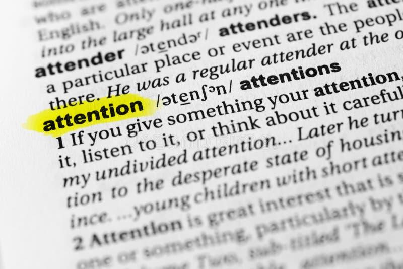 被突出的英国词`注意`和它的定义在字典 库存图片