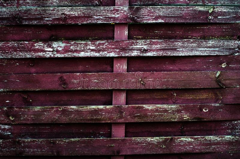 被绘的老木墙壁 红色背景 库存图片