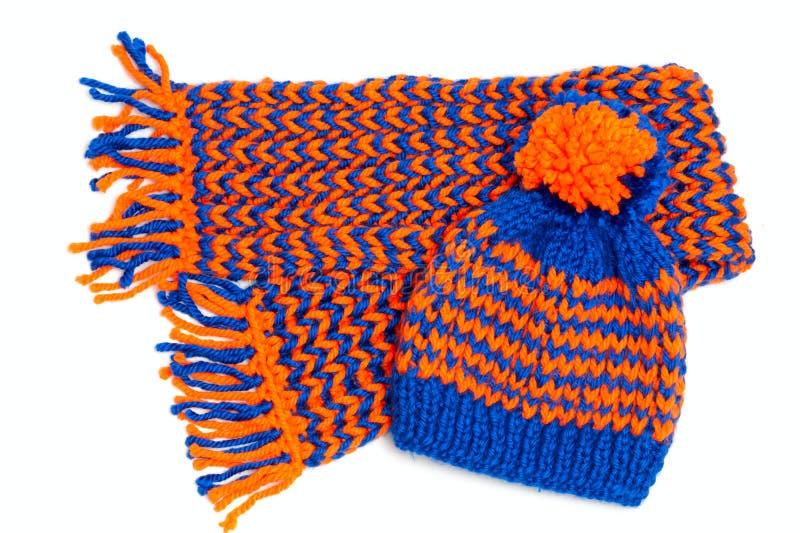 被编织的围巾和盖帽 图库摄影
