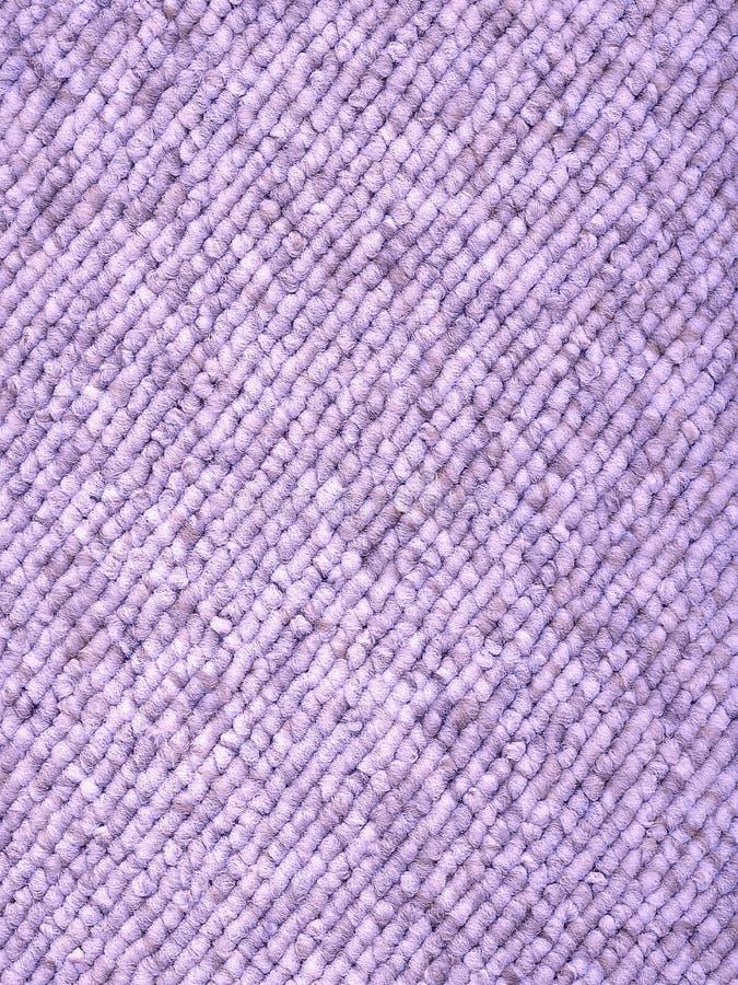 被编织的地毯淡紫色循环 库存照片