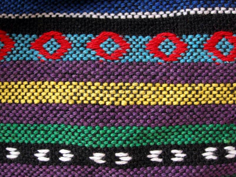 被编织的接近的种族织品 免版税库存照片