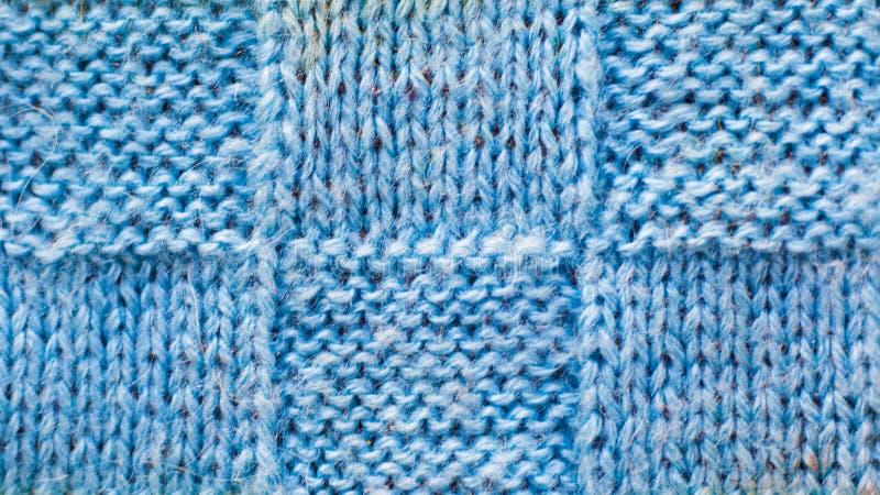 被编织的毛线,纹理样式浅兰的羊毛背景编织了织品 免版税库存照片