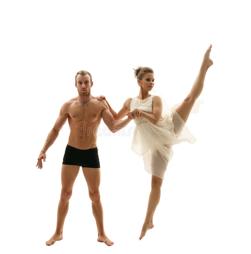 被聚焦的体操运动员和他的相当灵活的伙伴 免版税库存照片