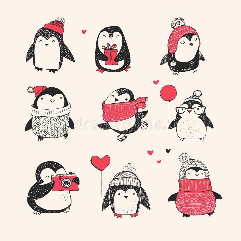 被设置的逗人喜爱的手拉的企鹅-圣诞快乐 皇族释放例证