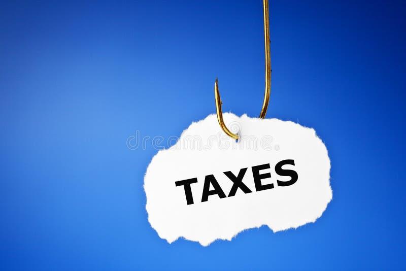 被钩的税概念 库存照片