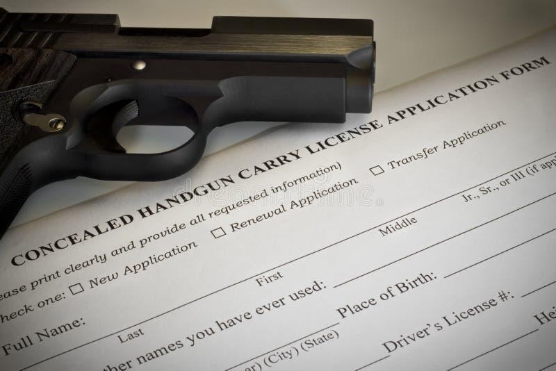 被隐瞒的手枪许可证应用 库存图片