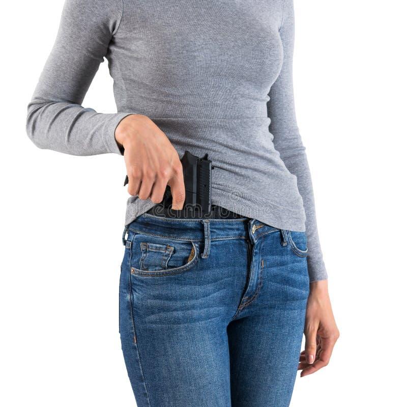 被隐瞒的运载的武器的城市作战手枪皮套有里面手枪的 库存照片