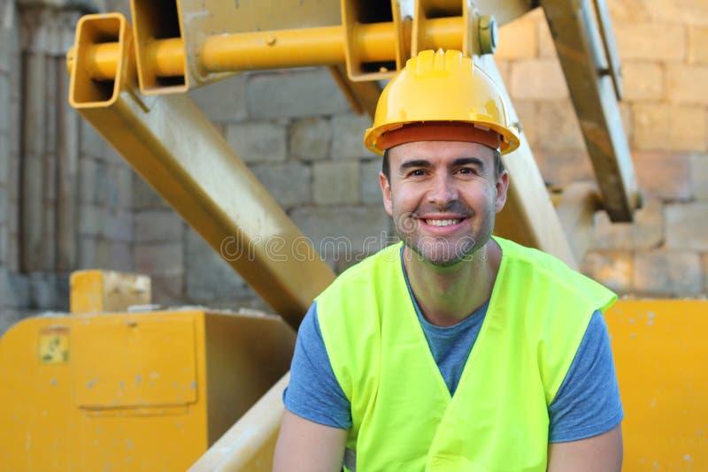 被隔绝的健康建筑工人微笑 库存图片
