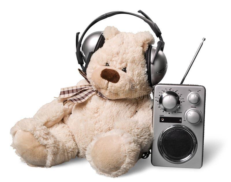 被隔绝的女用连杉衬裤亲爱在耳机和收音机  免版税库存照片