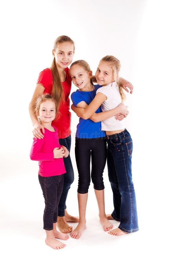 被隔绝的小组愉快的孩子 库存照片