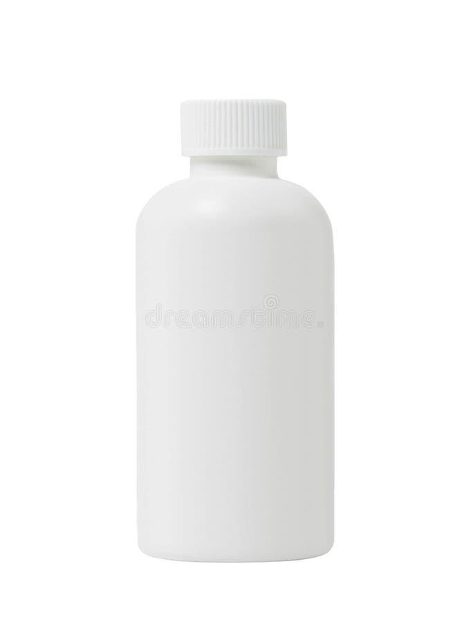 被隔绝的药片的白色塑料医疗容器 免版税图库摄影