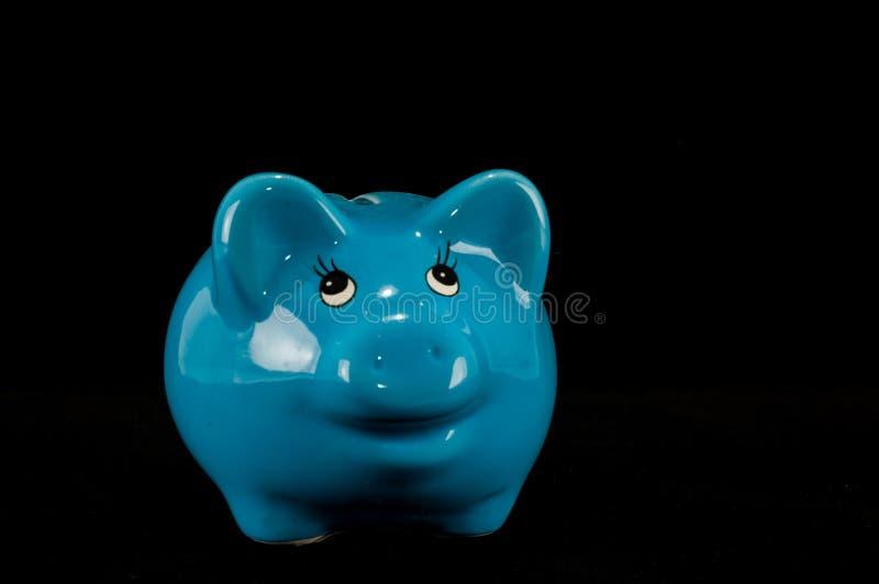 被隔绝的蓝色存钱罐或钱箱 免版税库存照片
