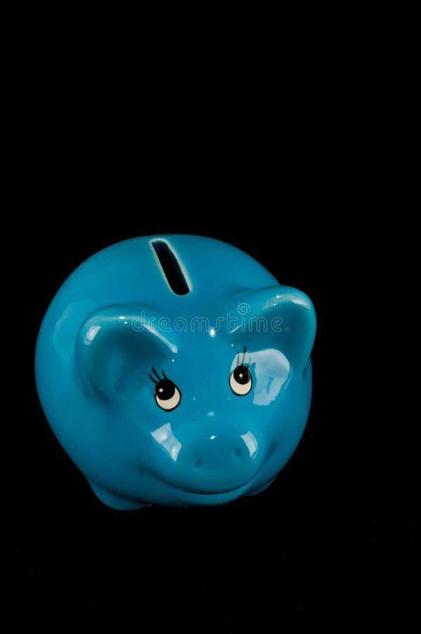 被隔绝的蓝色存钱罐或钱箱 免版税图库摄影