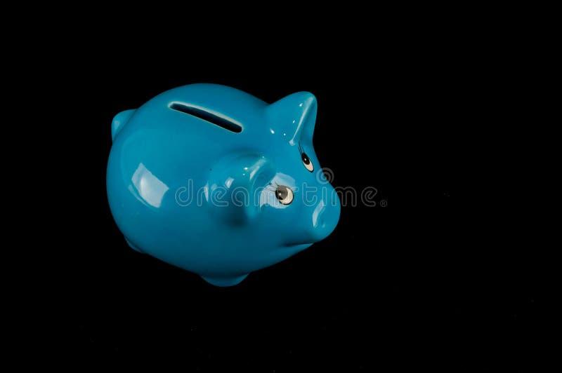 被隔绝的蓝色存钱罐或钱箱 图库摄影