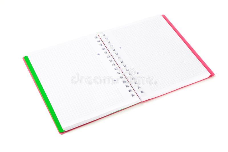 被隔绝的被摆正的空的笔记本 库存照片
