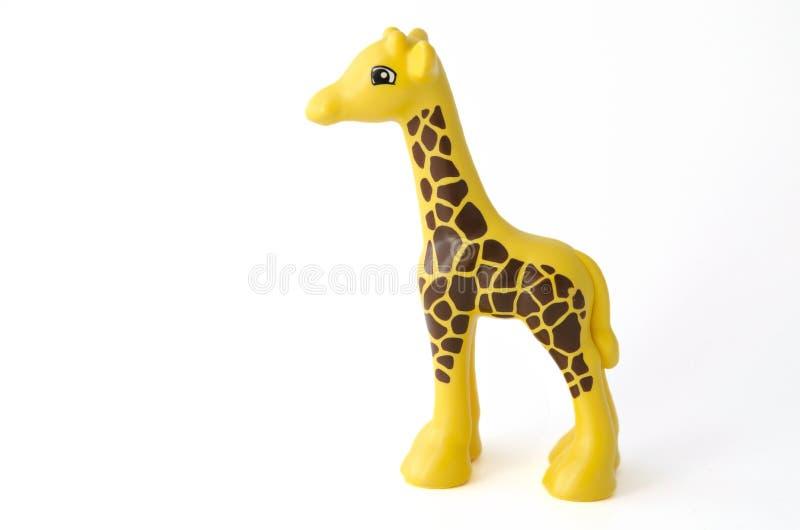 被隔绝的长颈鹿玩具 图库摄影