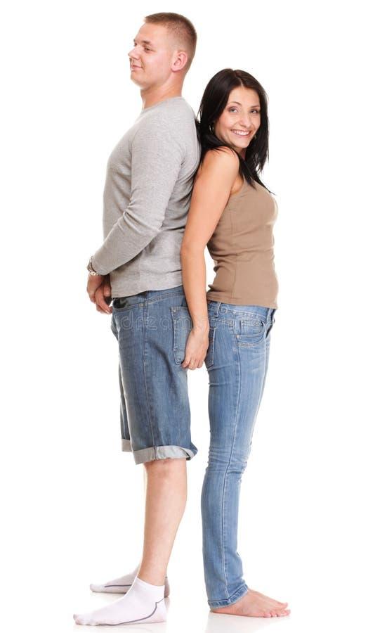 被隔绝的一对美好的年轻愉快的微笑的夫妇的画象 库存照片