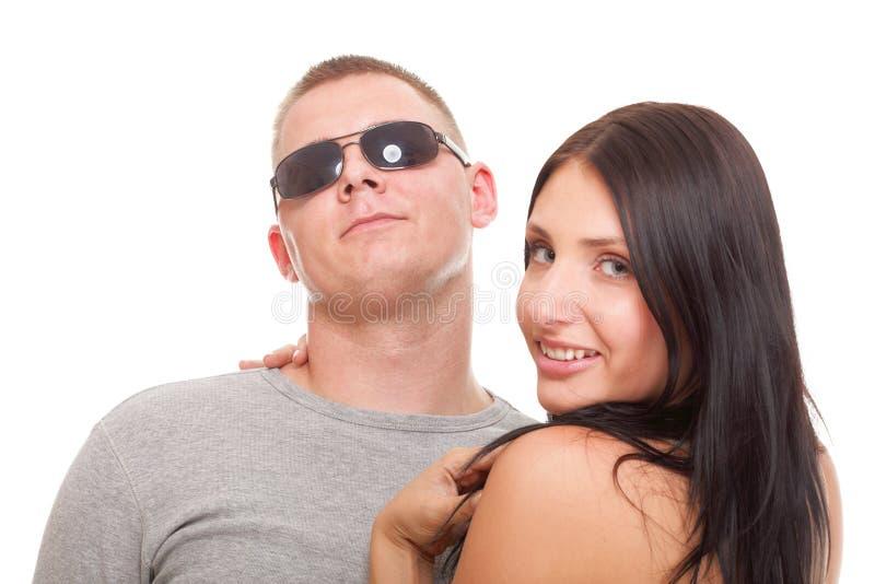 被隔绝的一对美好的年轻愉快的微笑的夫妇的画象 库存图片