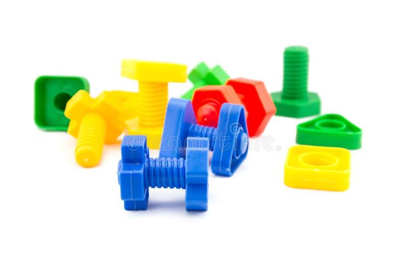 被隔绝的五颜六色和滑稽的基本要点玩具 免版税库存图片