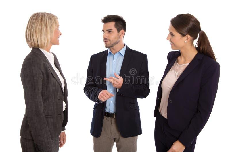 被隔绝的企业队:一起谈话的男人和的妇女 库存照片