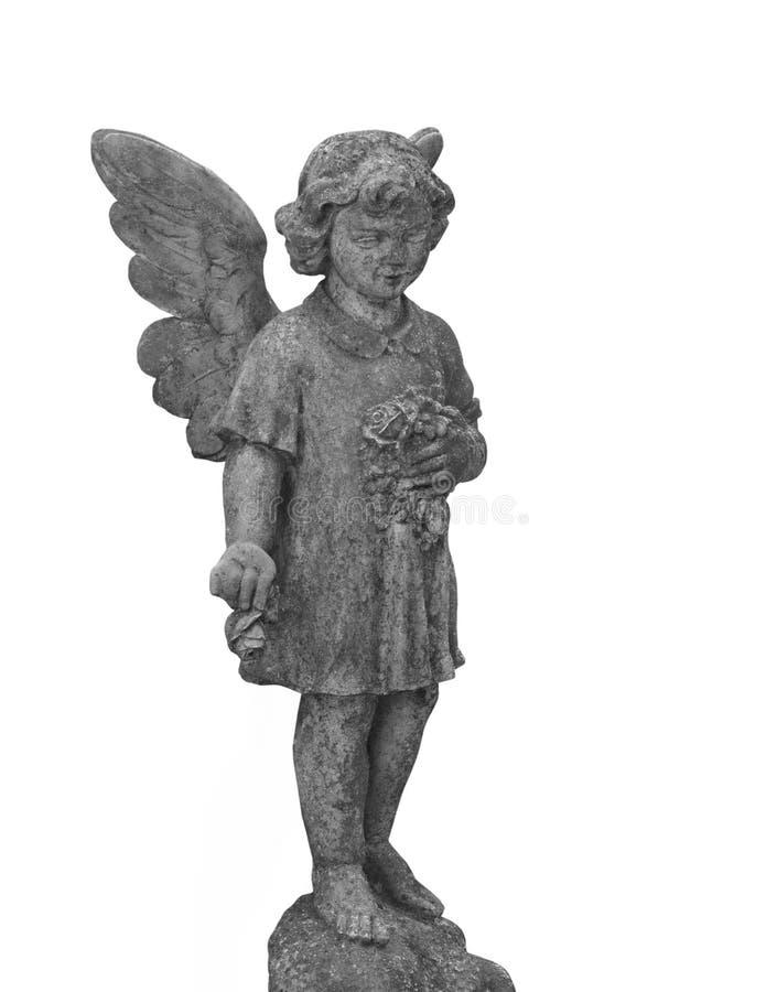 被隔绝的儿童天使的老石雕象 免版税库存图片