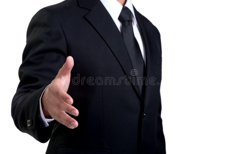 被隔绝的商人提供的握手 库存图片