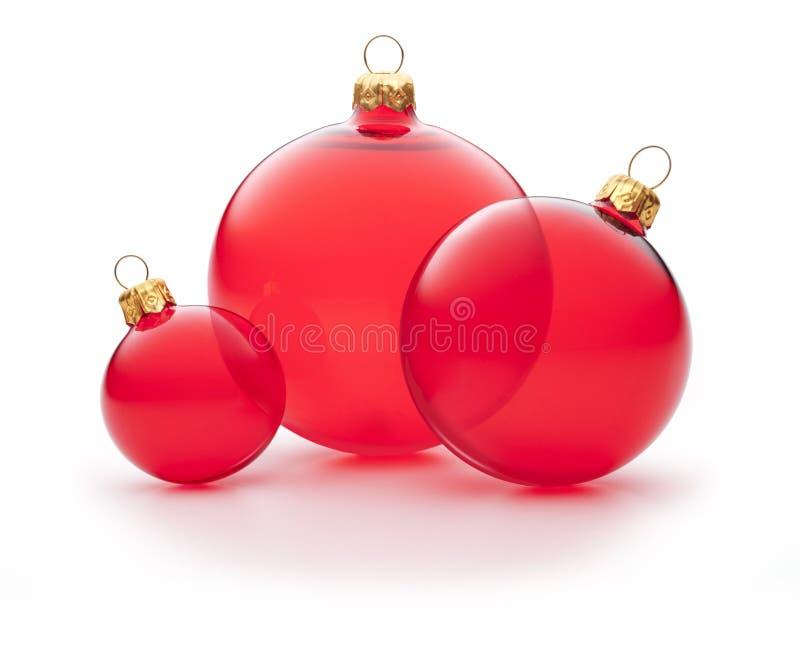 被隔绝的圣诞节红色装饰品 免版税库存照片