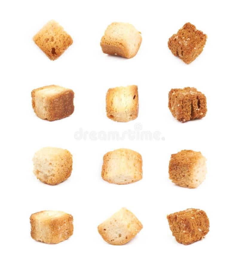 被隔绝的大蒜油煎方型小面包片 库存图片
