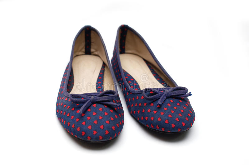 被隔绝的妇女平的鞋子 图库摄影
