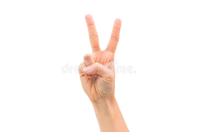 被隔绝的妇女手显示胜利标志 免版税库存照片