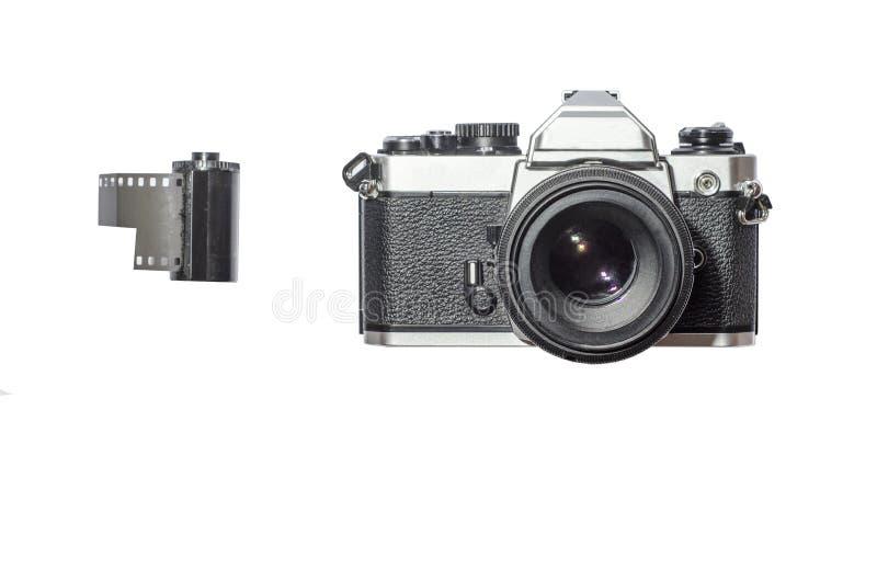 被隔绝的影片和类推照相机的卷 免版税库存图片