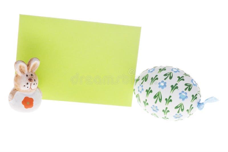 被隔绝的愿望卡片、复活节彩蛋和兔宝宝特写镜头  库存照片