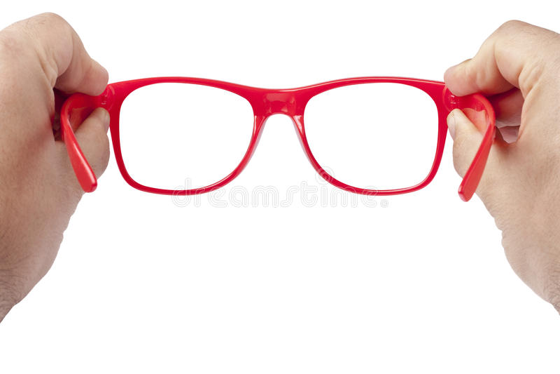 被隔绝的手红色眼镜聚焦 免版税图库摄影