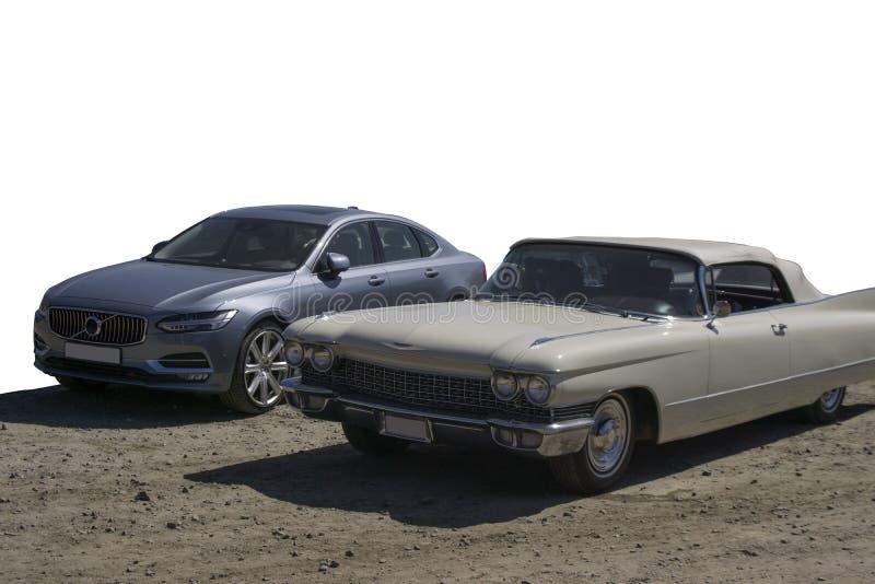 被隔绝的新和老汽车 免版税库存图片