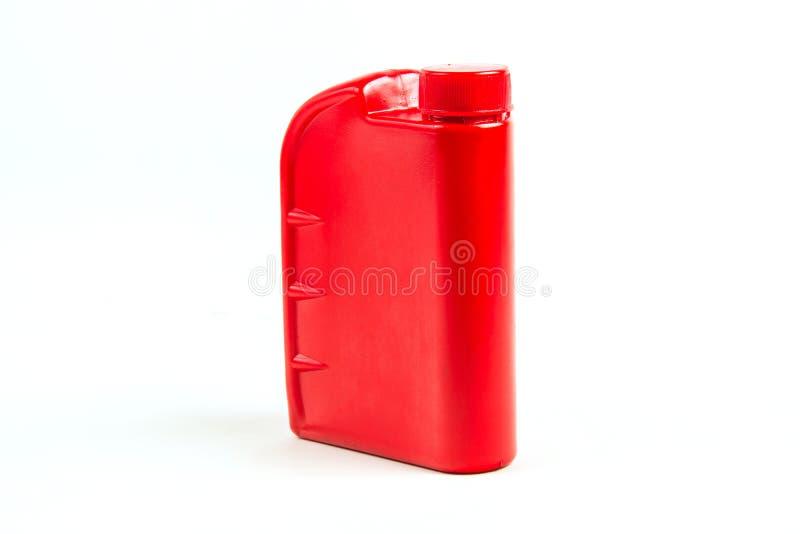 被隔绝的机油的,汽车油瓶塑胶容器 免版税库存图片