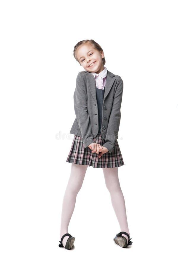 被隔绝的校服的美丽的小女孩 免版税库存照片