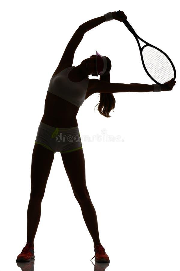 被隔绝的演播室剪影的一个女子网球员 免版税库存照片