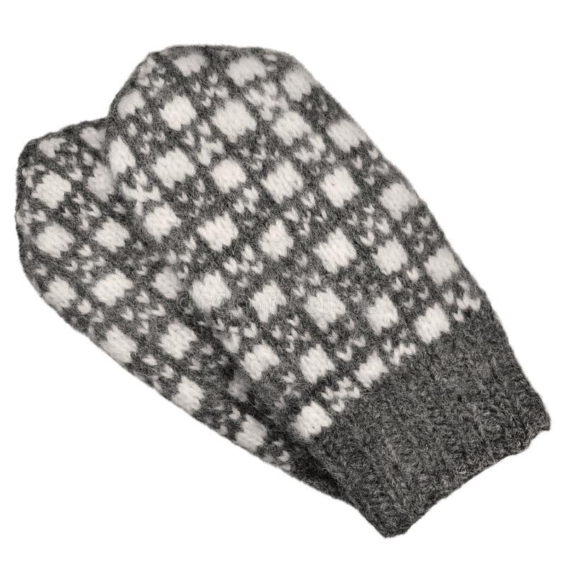 被隔绝的灰色手套对,灰色白色构造了羊毛手套样式,被编织的温暖的羊毛冬天无指的失去指的手套细节,大 免版税库存照片
