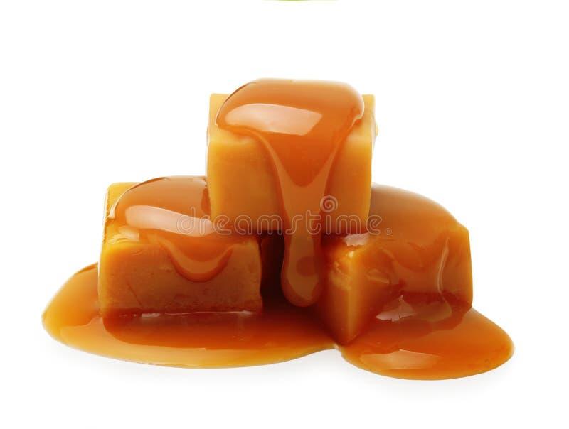 被隔绝的焦糖奶糖和调味汁 库存图片