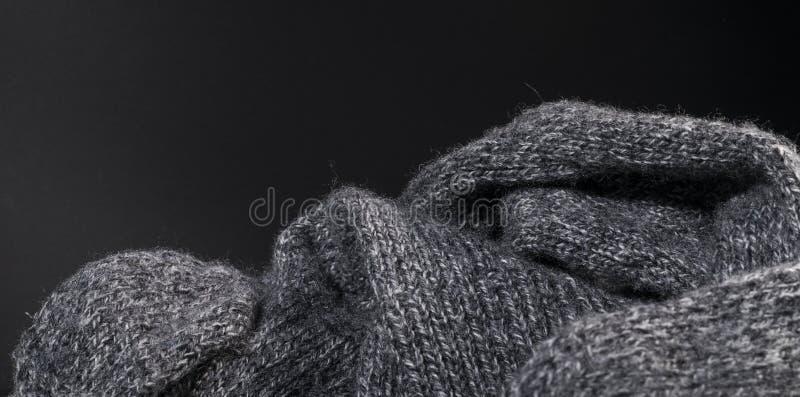 被隔绝的特写镜头灰色羊毛织品纹理背景 免版税库存照片