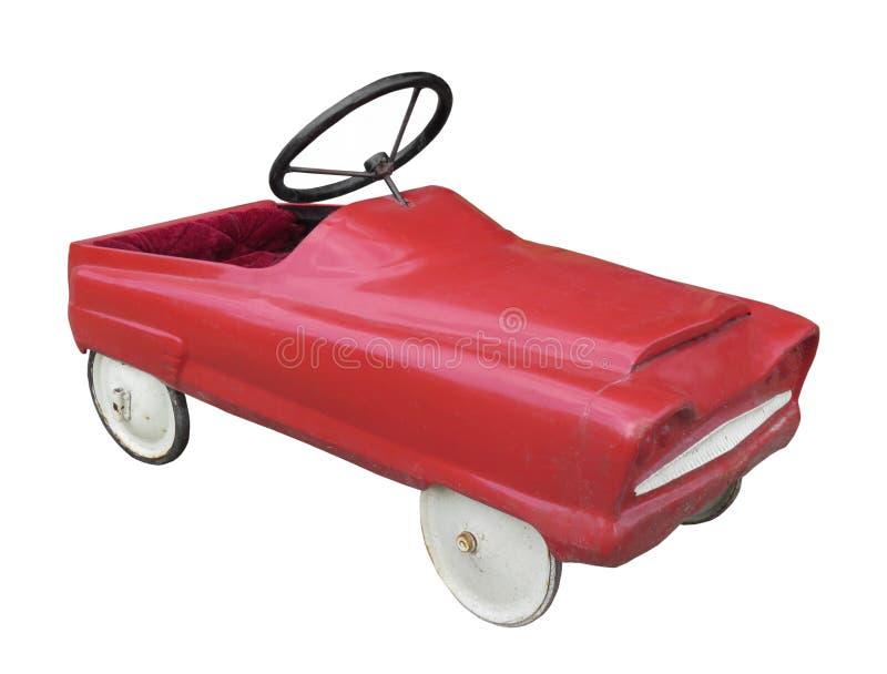 被隔绝的红色儿童脚蹬汽车。 免版税库存照片