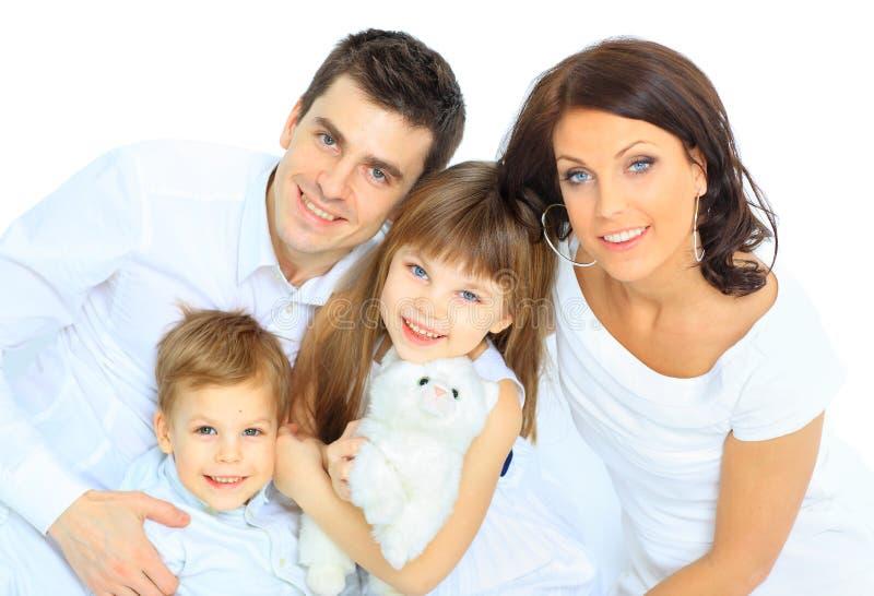 -被隔绝的美丽的愉快的家庭 库存照片