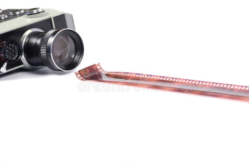被隔绝的老照相机和影片小条 库存图片