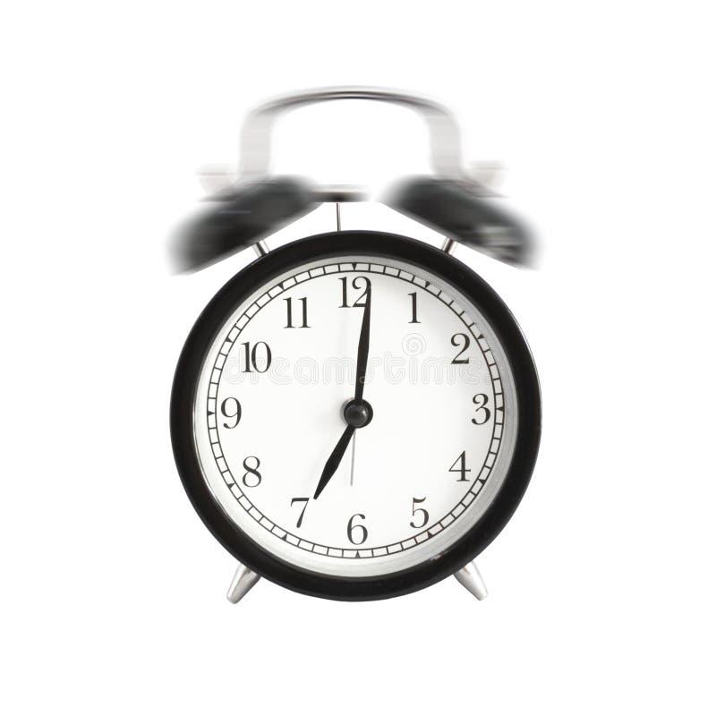 被隔绝的闹钟敲响 在下午7点上午或的闹钟设置 图库摄影