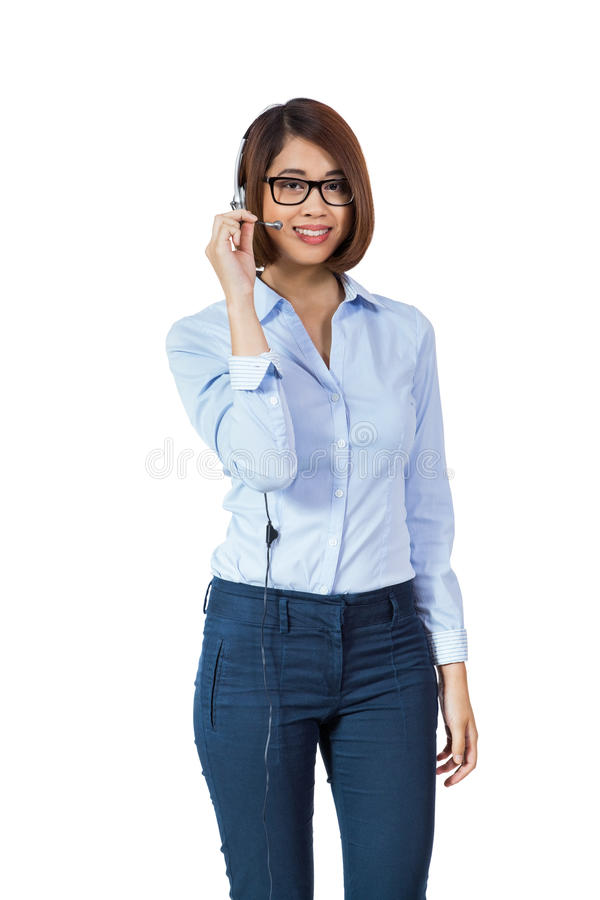被隔绝的年轻人微笑的亚洲女实业家电话中心代理 库存图片